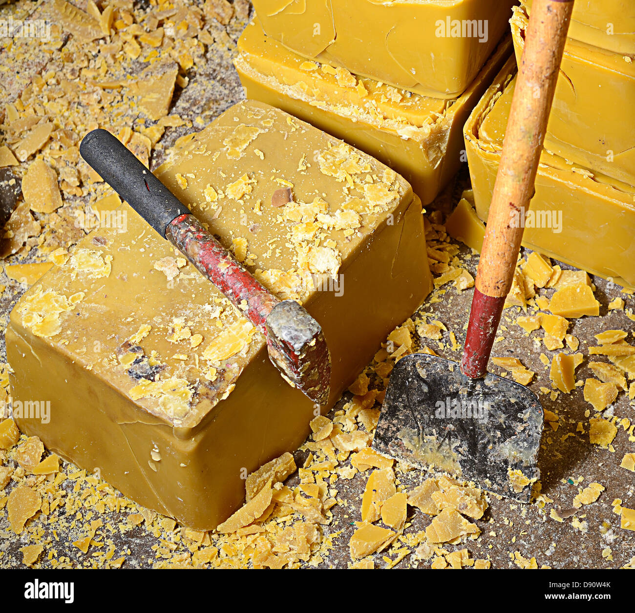 blocks of honey bee's wax and cutting tools - Stock Image