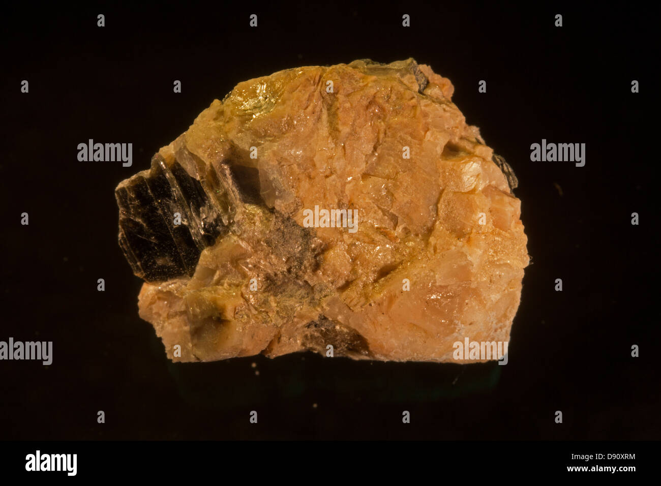 Yttrotantalite, Sweden. Rare earth element ore of Yttrium. - Stock Image