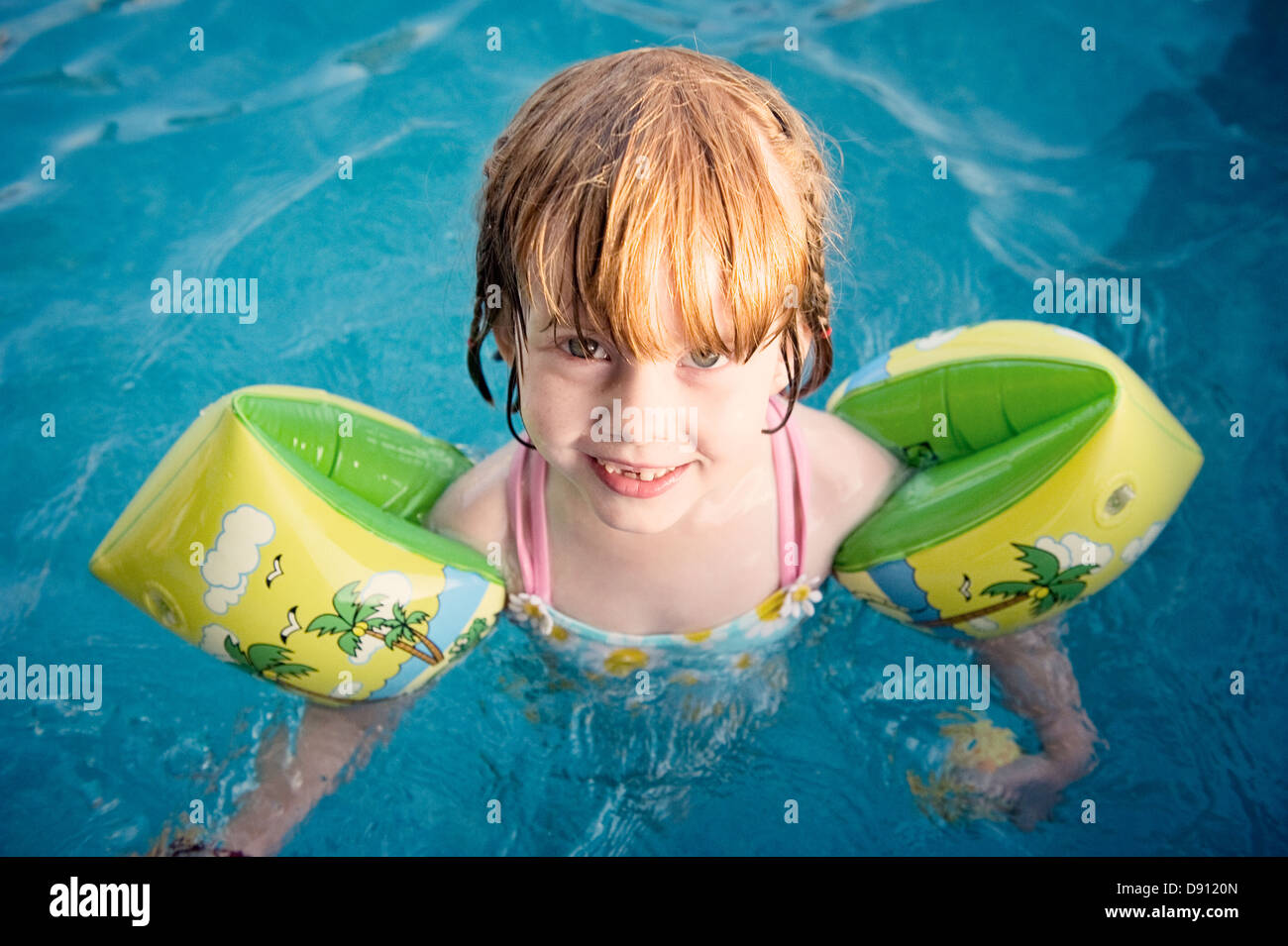 Portrait of girl in swimming pool - Stock Image