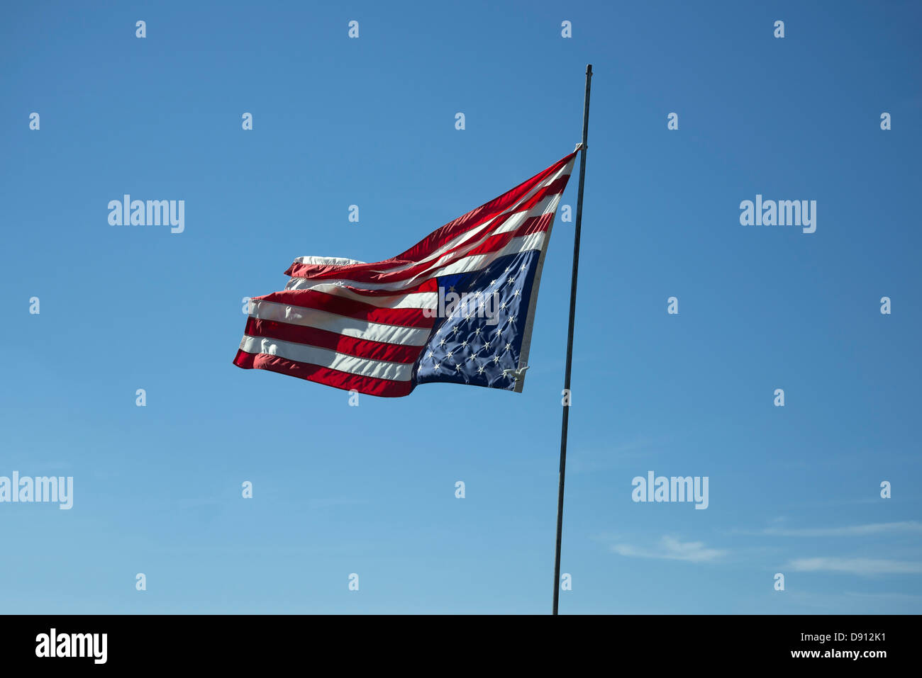 American flag flying upside down is a sign of distress. - Stock Image
