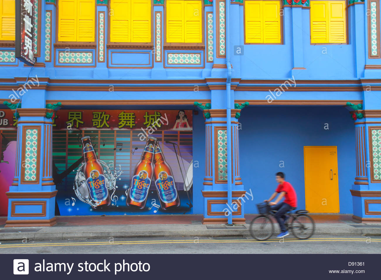 Singapore Little India Jalan Besar street scene building Asian teen boy bicycle riding bar nightclub club Tiger Stock Photo