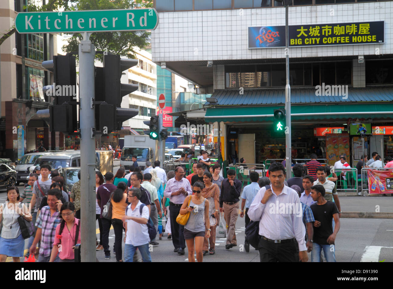 Singapore little india kitchener road asian man woman pedestrian crossing hanzi characters chinese language stock