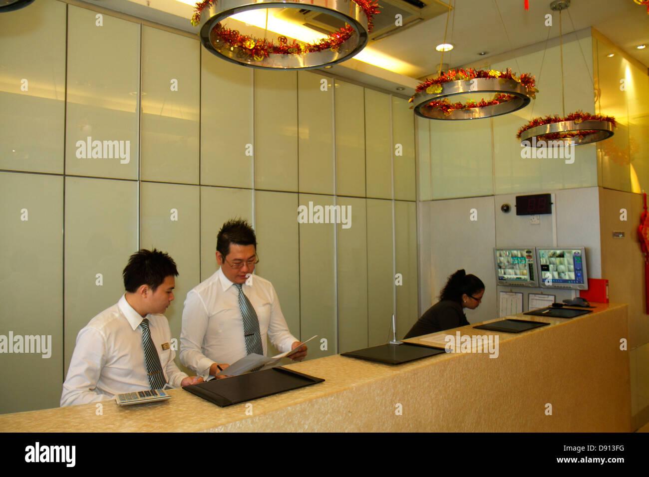 Singapore Jalan Besar Hotel 81 Lobby Front Desk Asian Man Woman Job Service  Inside Interior Budget Hotel