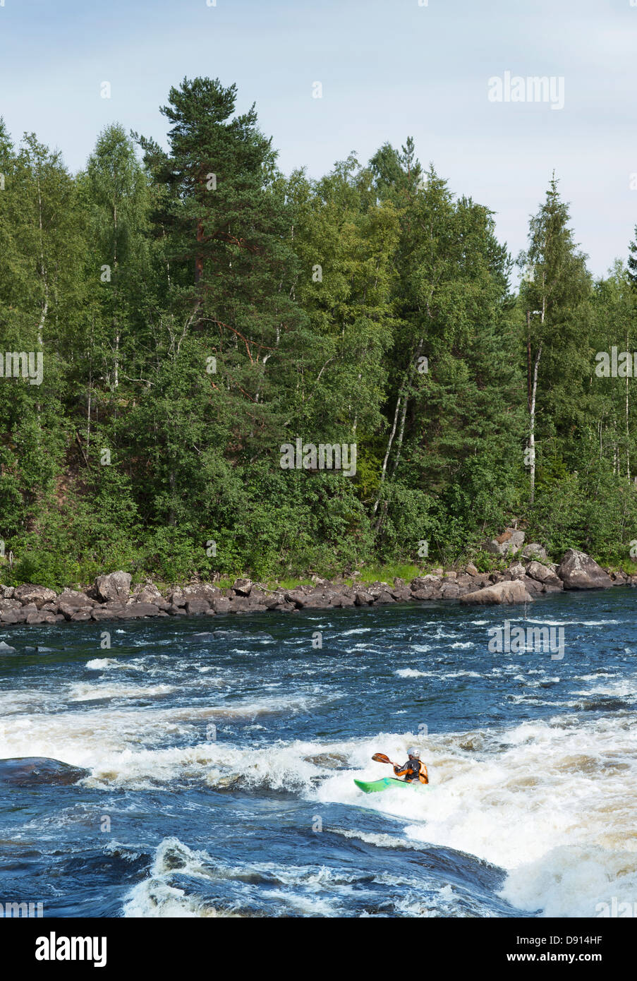 People rafting at river - Stock Image
