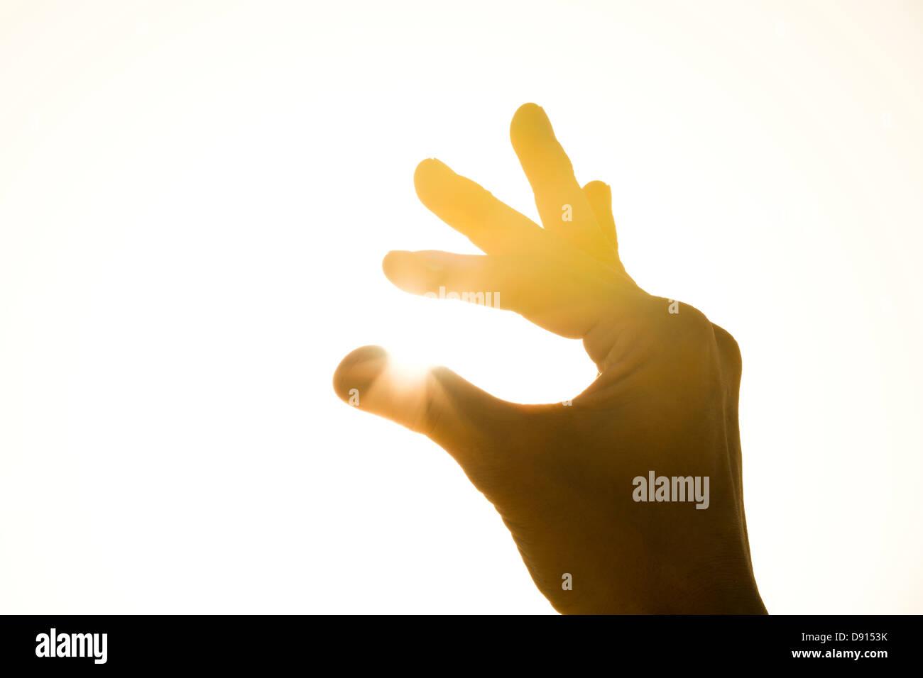 Human hand holding sun - Stock Image