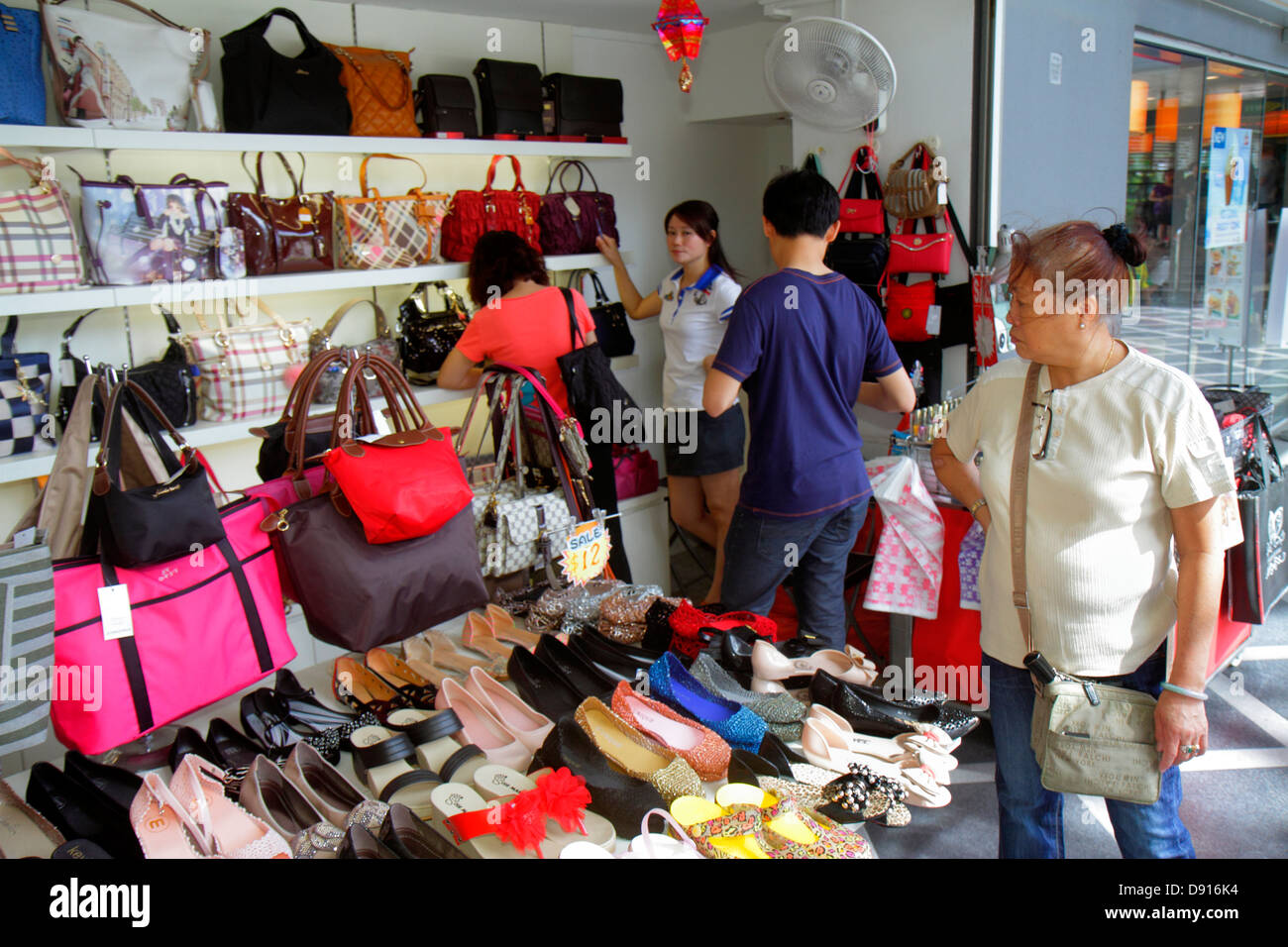 556afb3af60c Singapore Kallang Road Asian woman shopping women s shoes handbags for sale