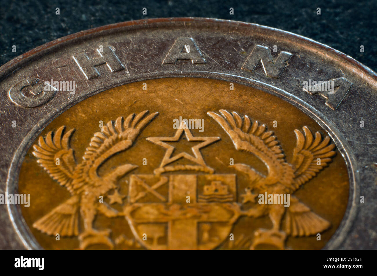 old ghanian coin, ghana, in studio setting - Stock Image