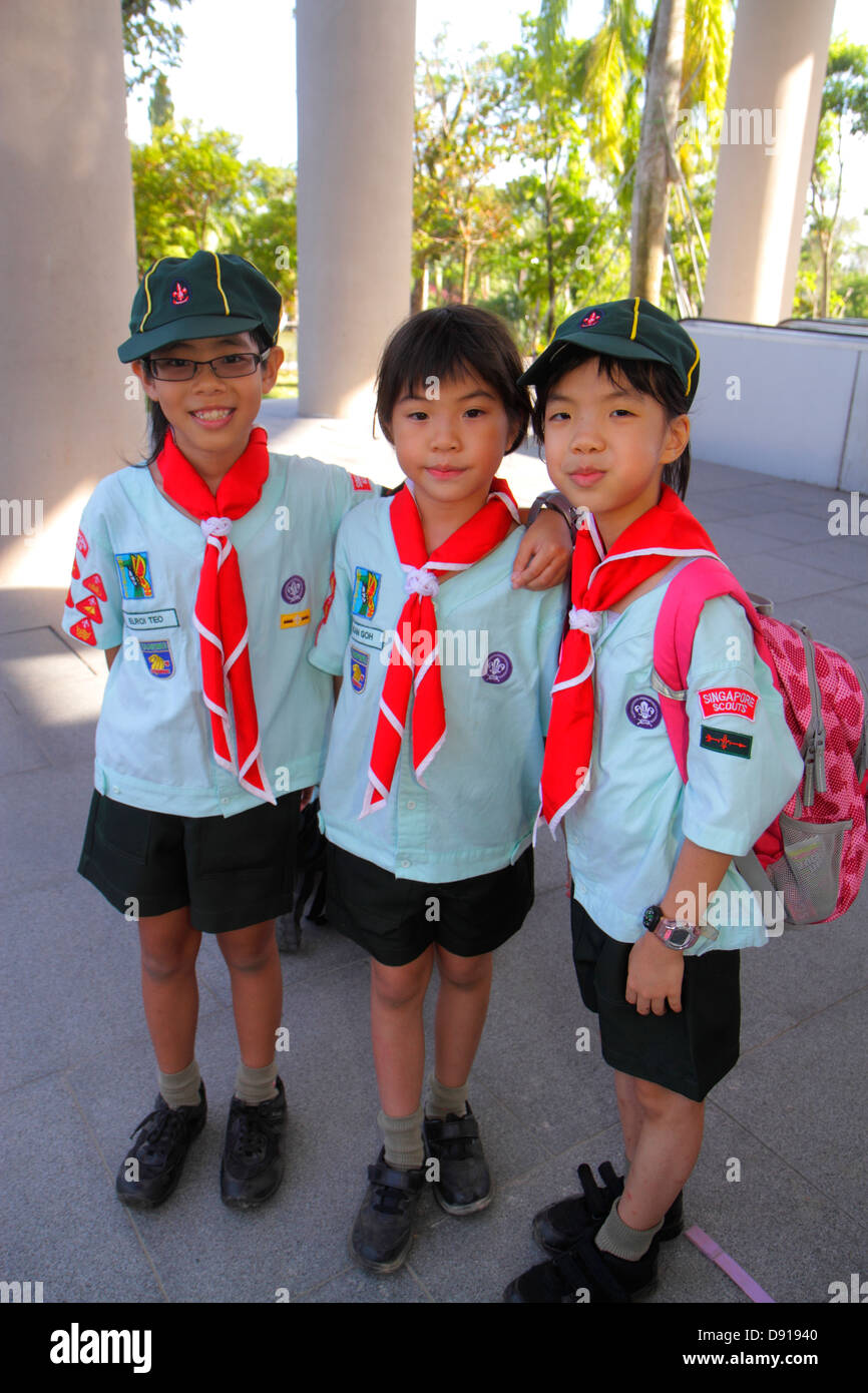 Singapore Gardens by the Bay park Asian girl scout scouts uniform - Stock Image