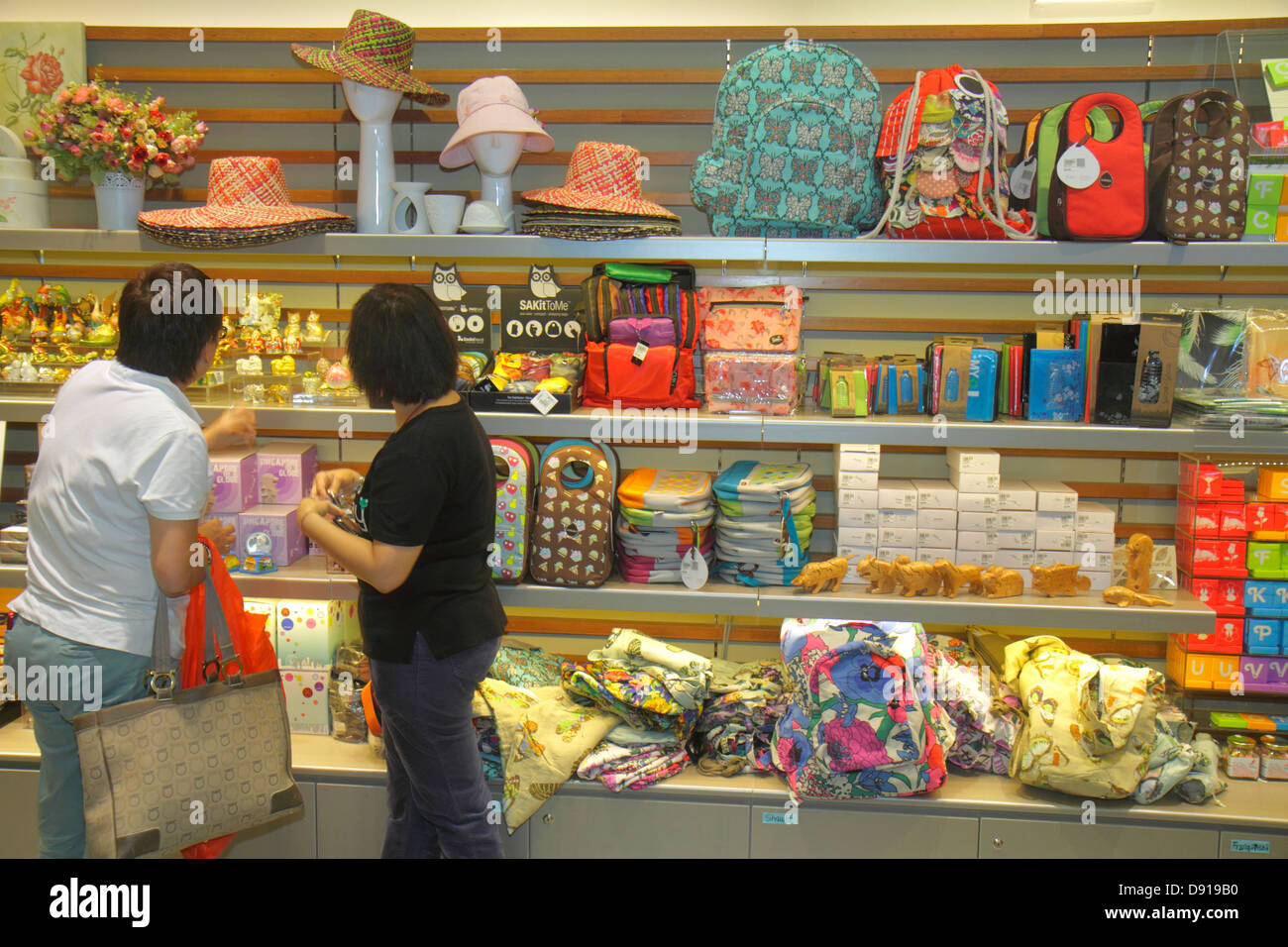 Singapore Gardens by the Bay park gift shop store souvenirs Asian woman shopping - Stock Image