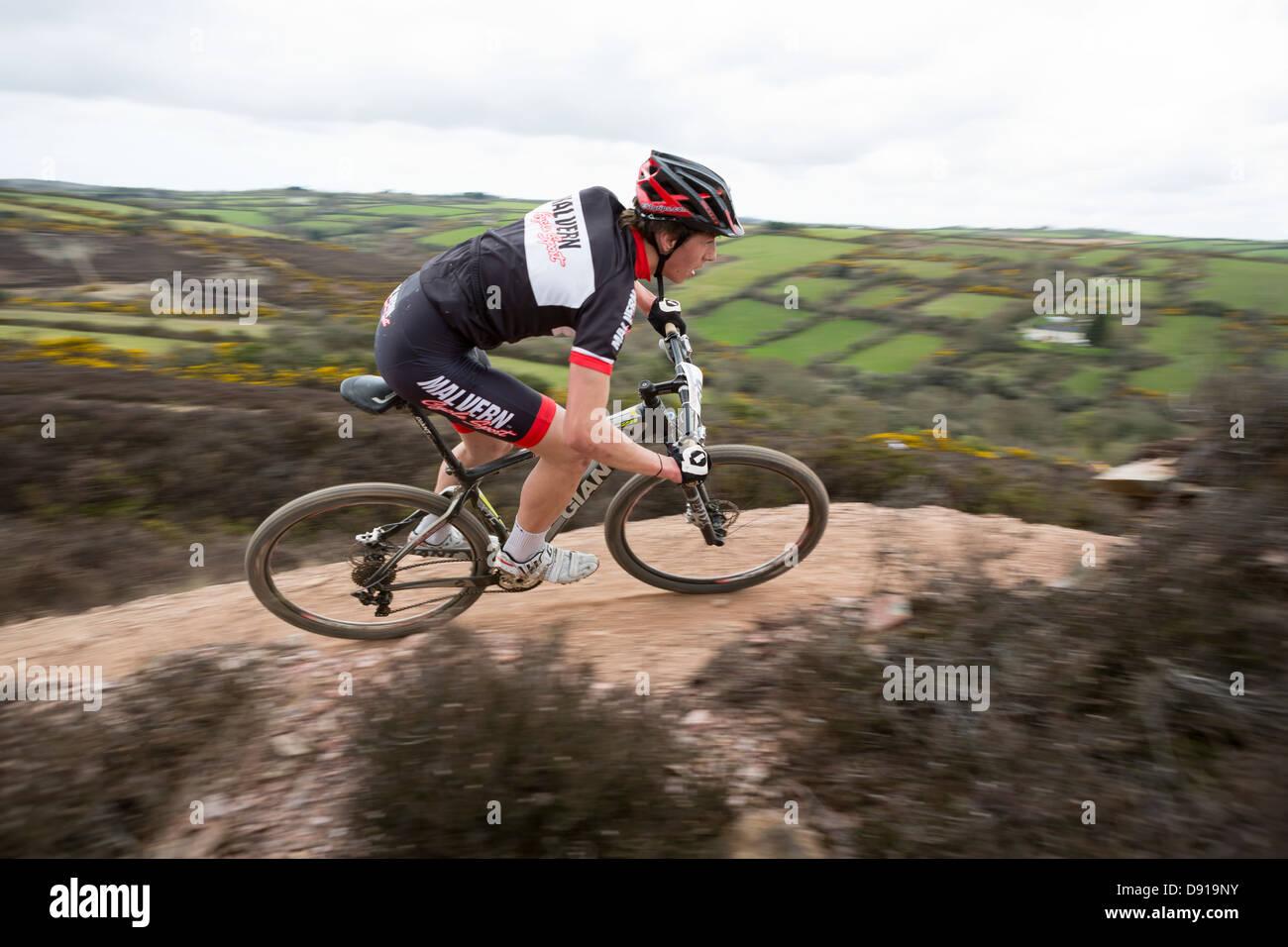 WHEAL MAYD VALLEY, REDRUTH, UK. British XC Series Round 2, mountain bike cross country race. Blurred background - Stock Image