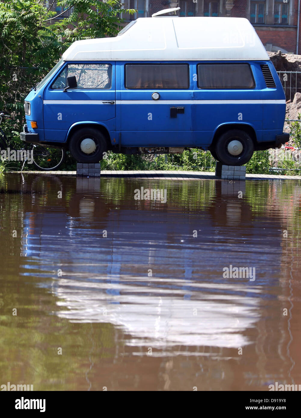 Owners of a VW van have placed their vehicle on stone bases to protect it against flooding in Magdeburg, Germany, - Stock Image