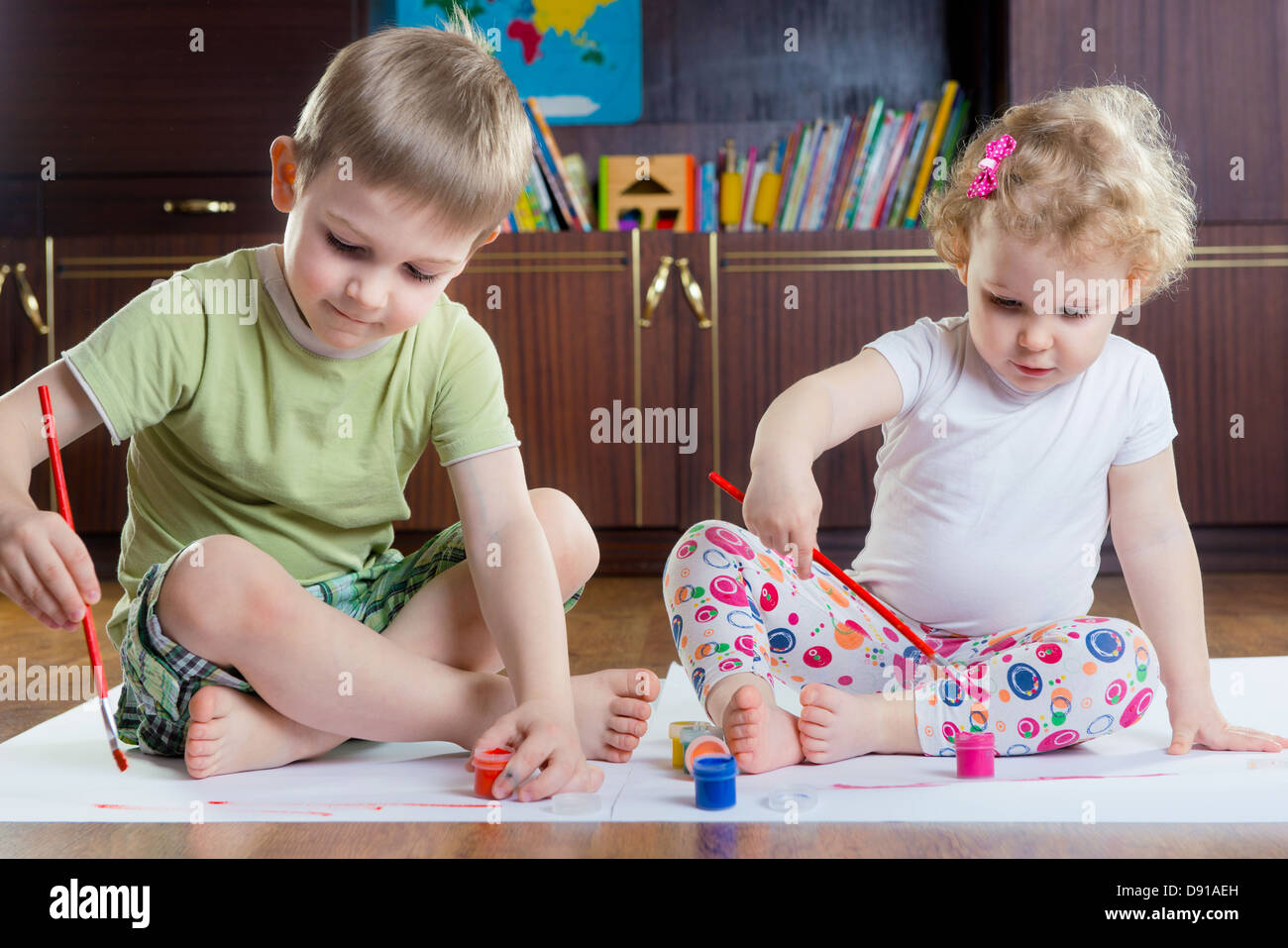 Cute Brother And Sister Painting With Colorful Paints Stock Photo