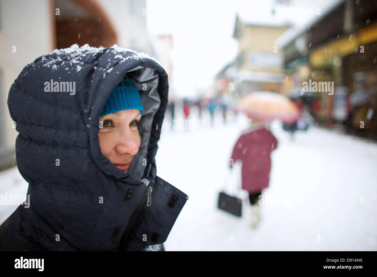 A woman on a pedestrian precinct, Chamonix, France. - Stock Image
