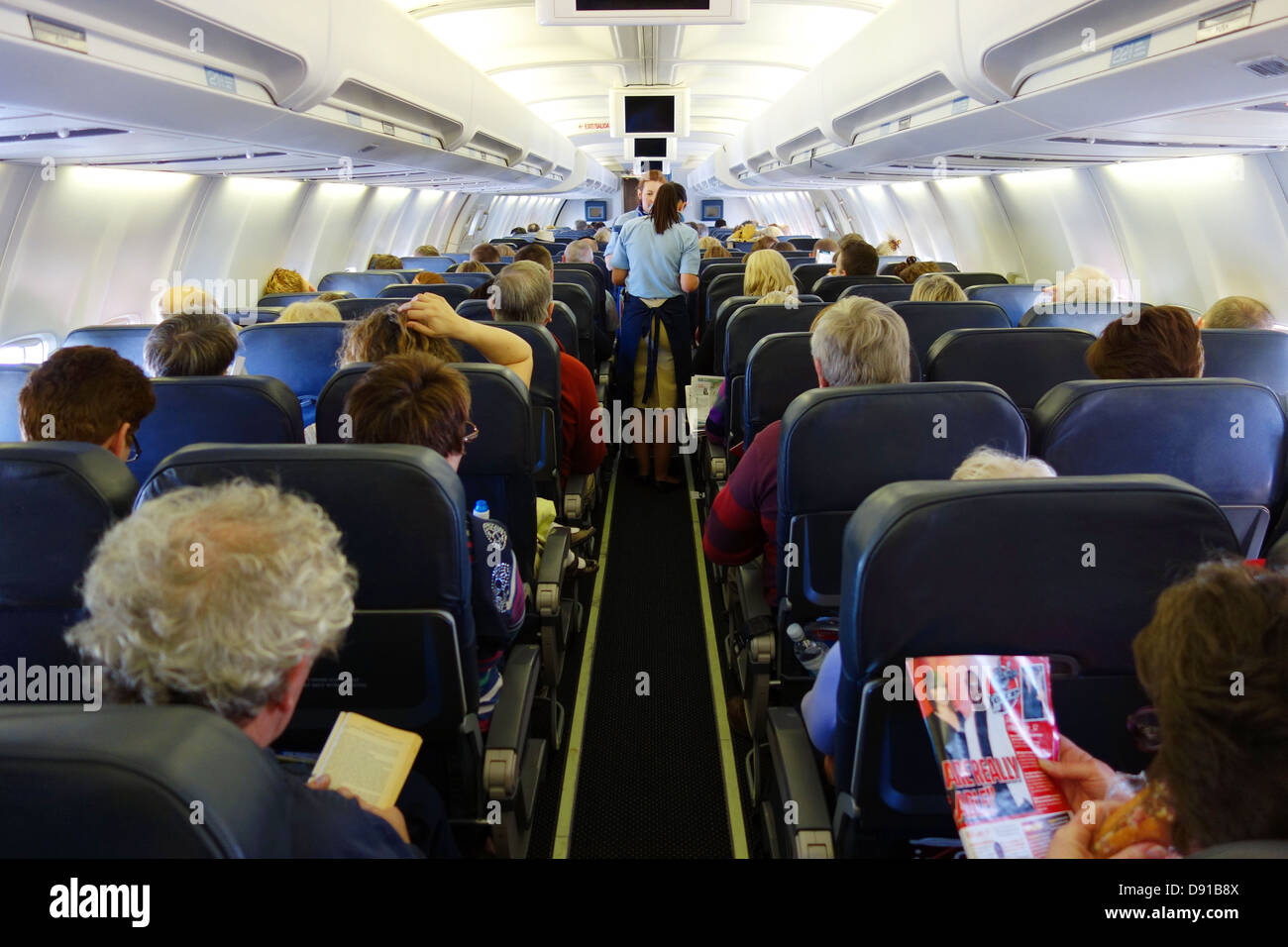 Passengers On A Aeroplane Interior Of Seating Area On