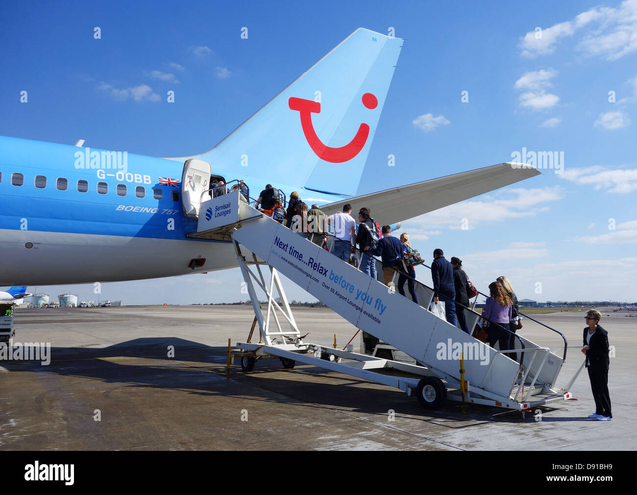 Passengers boarding a Thomson flight, UK - Stock Image