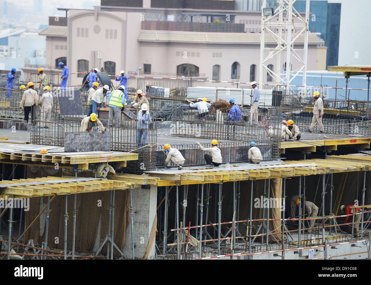 Dubai building industry, construction work being carried out in the city of Dubai, United Arab Emirates - Stock Image