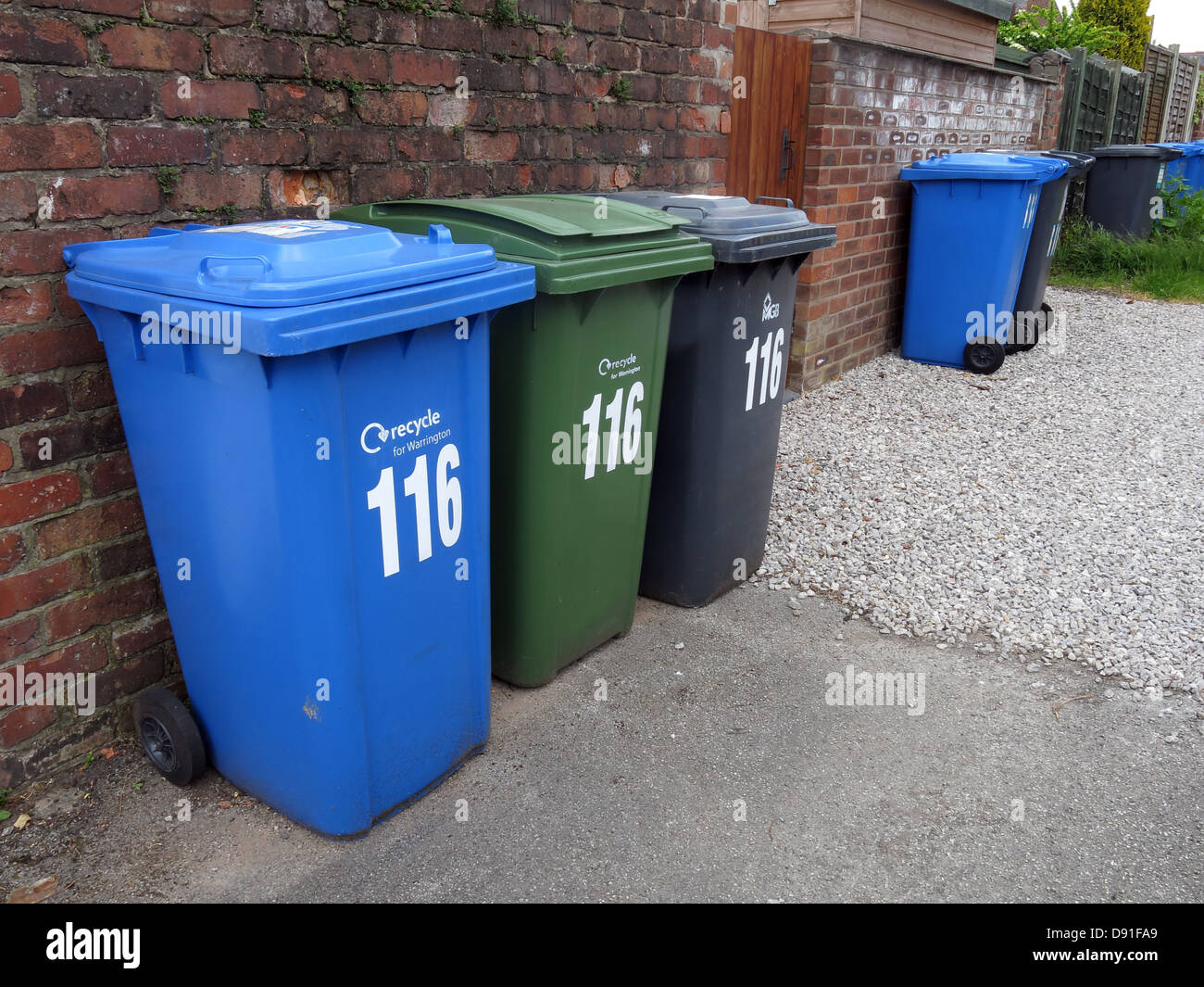 The many wheelie bins now required for domestic households in England, UK Blue for recycling, Green Garden Waste, - Stock Image