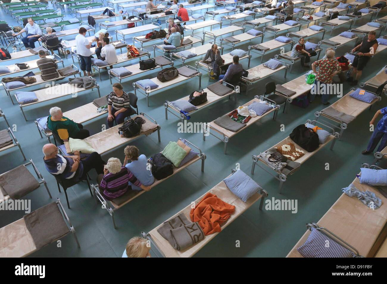 Evacuated residents from municipalities of the Elbe-Saale lie on beds of an emergency shelter in Eggersdorf, Germany, - Stock Image