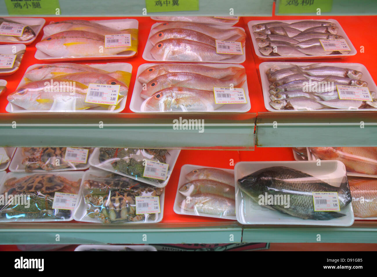 Singapore Jalan Besar convenience store seafood fish crabs for sale packaged - Stock Image