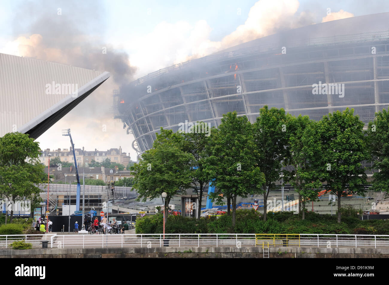 Hydro, Glasgow, Scotland, UK. 8th June 2013. Fire takes a firm hold at the unfinished Hydro arena. Fire spread through Stock Photo