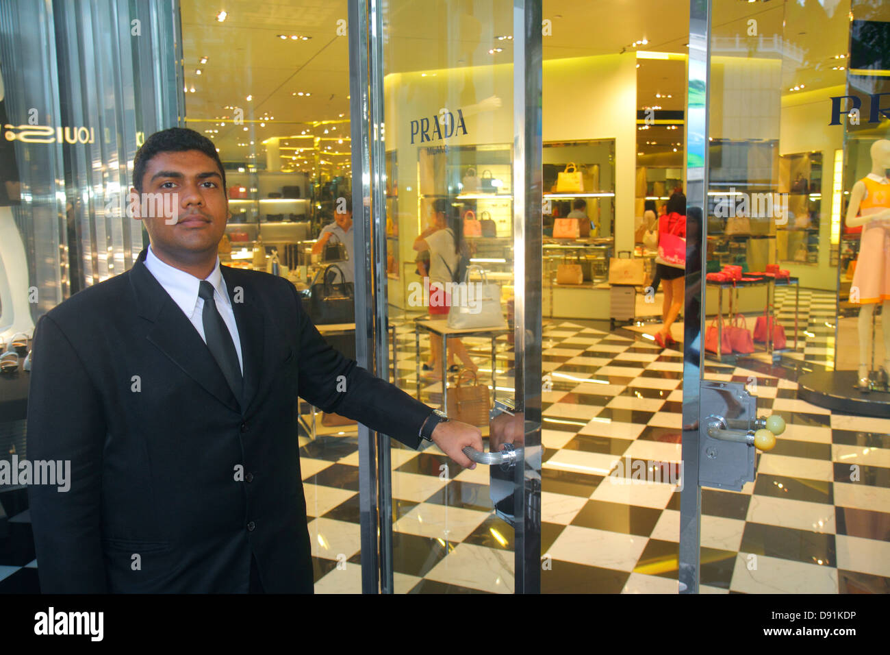 Singapore Orchard Road shopping Ion mall complex Asian man doorman Prada  Italian fashion designer women s handbags 9bf76e62d2