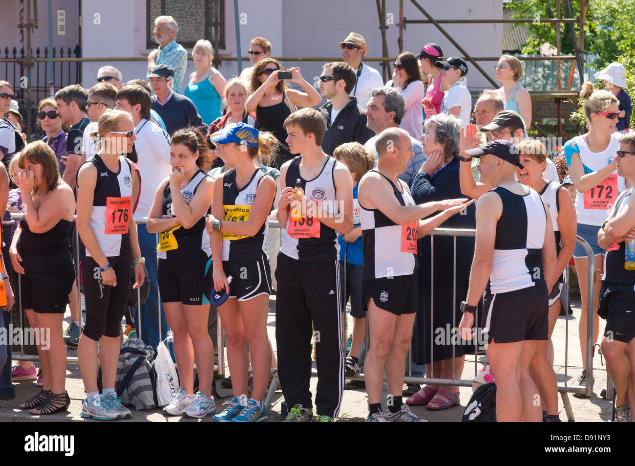 Llanwrtyd Wells, UK. 8th June 2013. Competitors wait for the Start. Over 400 runners compete against 65 horses in the Man V Horse 23 mile marathon, over gruelling mountainous terrain.The event was conceived by Gordon Green at his pub the Neuadd Arms in 1980 upon overhearing a discussion whether a man was equal to a horse running cross country over distance. The cash prize for beating a horse was increased each year by £1,000 until Huw Lobb won £25,000 in 2004 beating the first horse by 2 mins with a time of 2:05:19. Credit: Graham M. Lawrence/Alamy Live News. Stock Photo