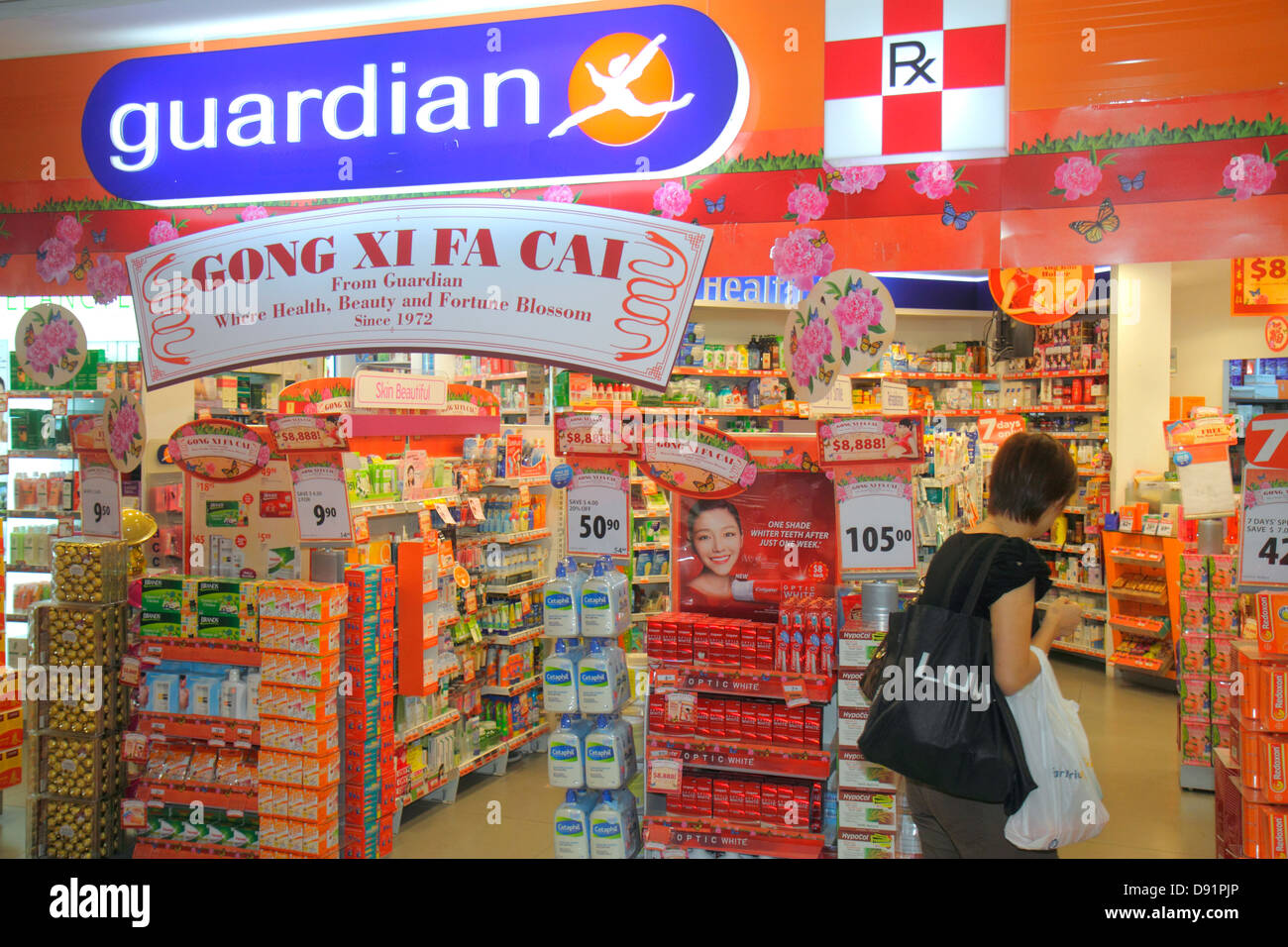 Singapore Bishan Place Junction 8 shopping mall complex Guardian pharmacy drugstore sign banner Happy Chinese New Stock Photo
