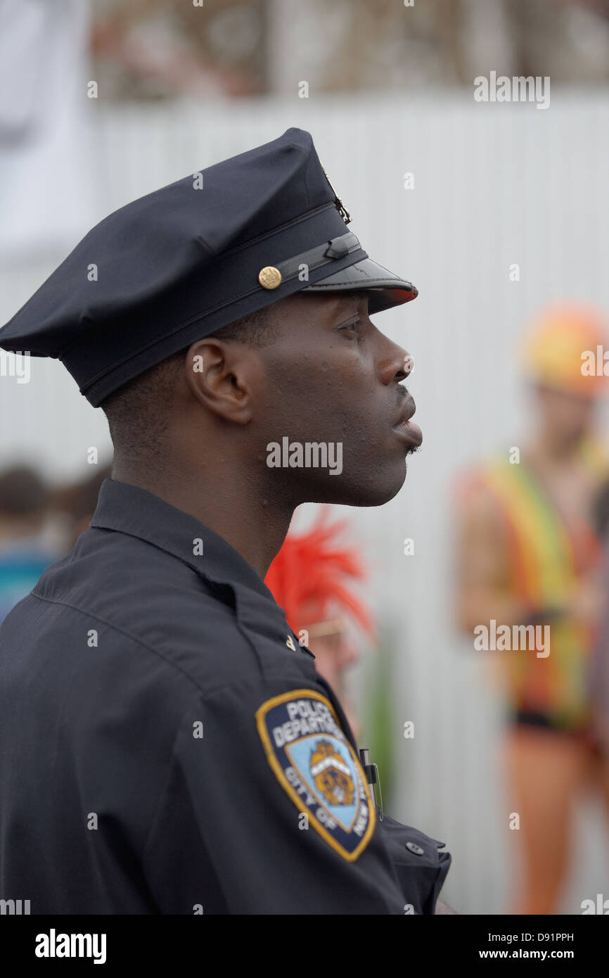 NYPD Officer Watching Over the Coney Island Mermaid Parade - Stock Image