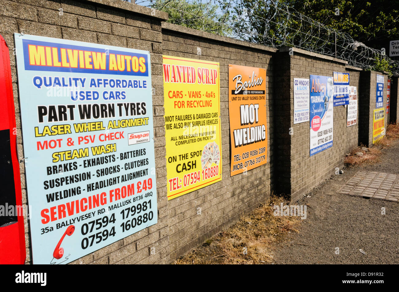 Signs for car repair/MOT work/Scrappage outside a Vehicle MOT Testing Centre - Stock Image