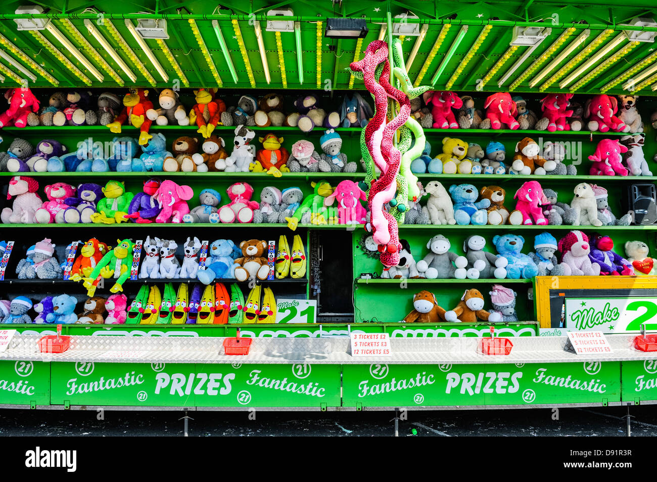 'Blackjack' fairground stall offering cuddly toys as prizes for having tickets totalling 21. - Stock Image