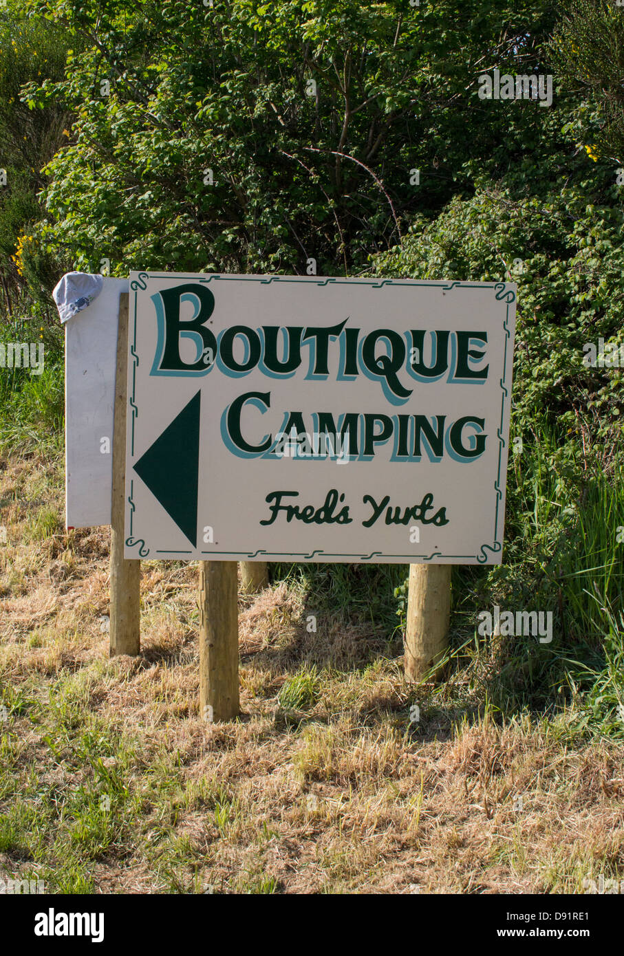 A sign leading to a boutique campsite at Hay On Wye during the Hay Festival. - Stock Image