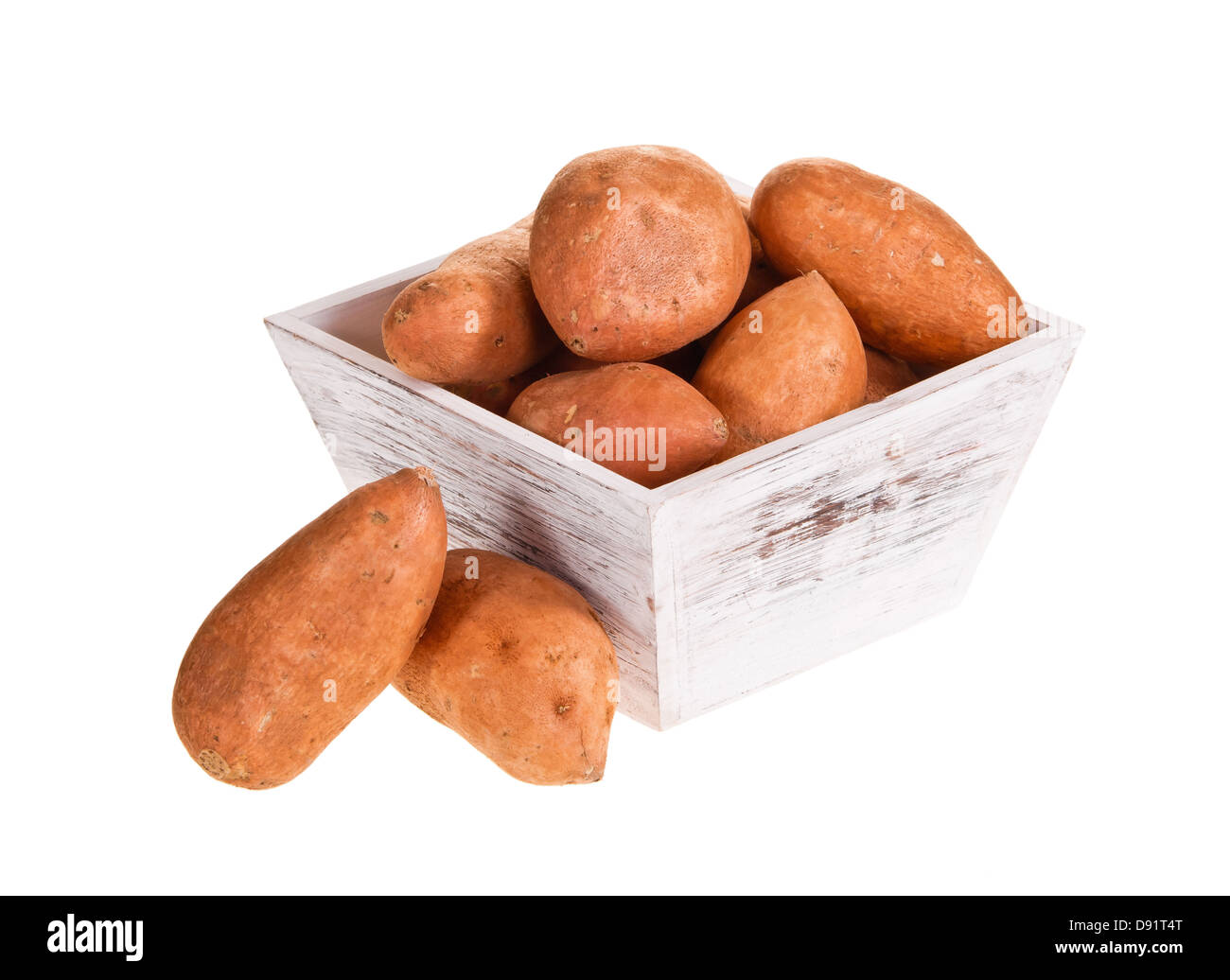 Sweet potatoes, rich in vitamins and minerals, in white wooden container isolated over white - Stock Image