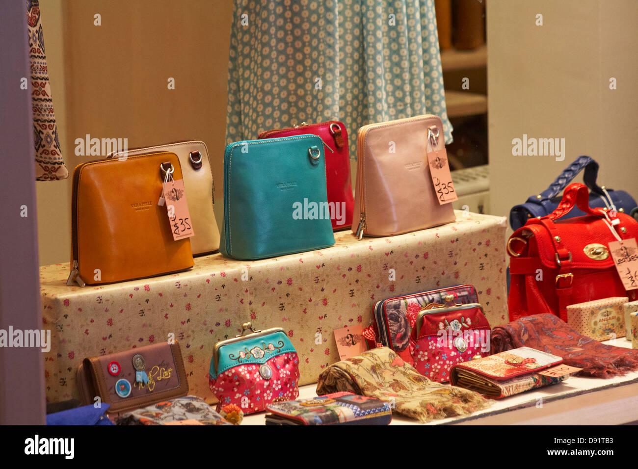 handbags in shop at Oxford indoor market in May Stock Photo