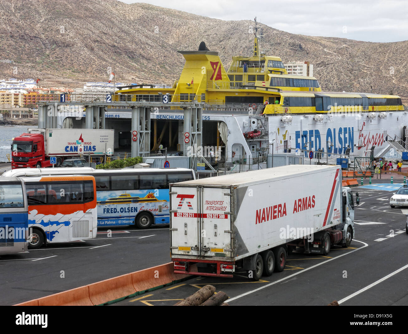 Fred Olsen Trimaran loading at Ferry port at Los Cristianos town, Southern Tenerife, Canary Islands Spain - Stock Image