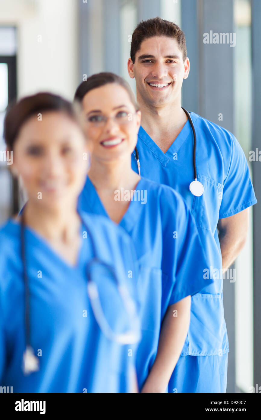 portrait of group hospital staff in office - Stock Image