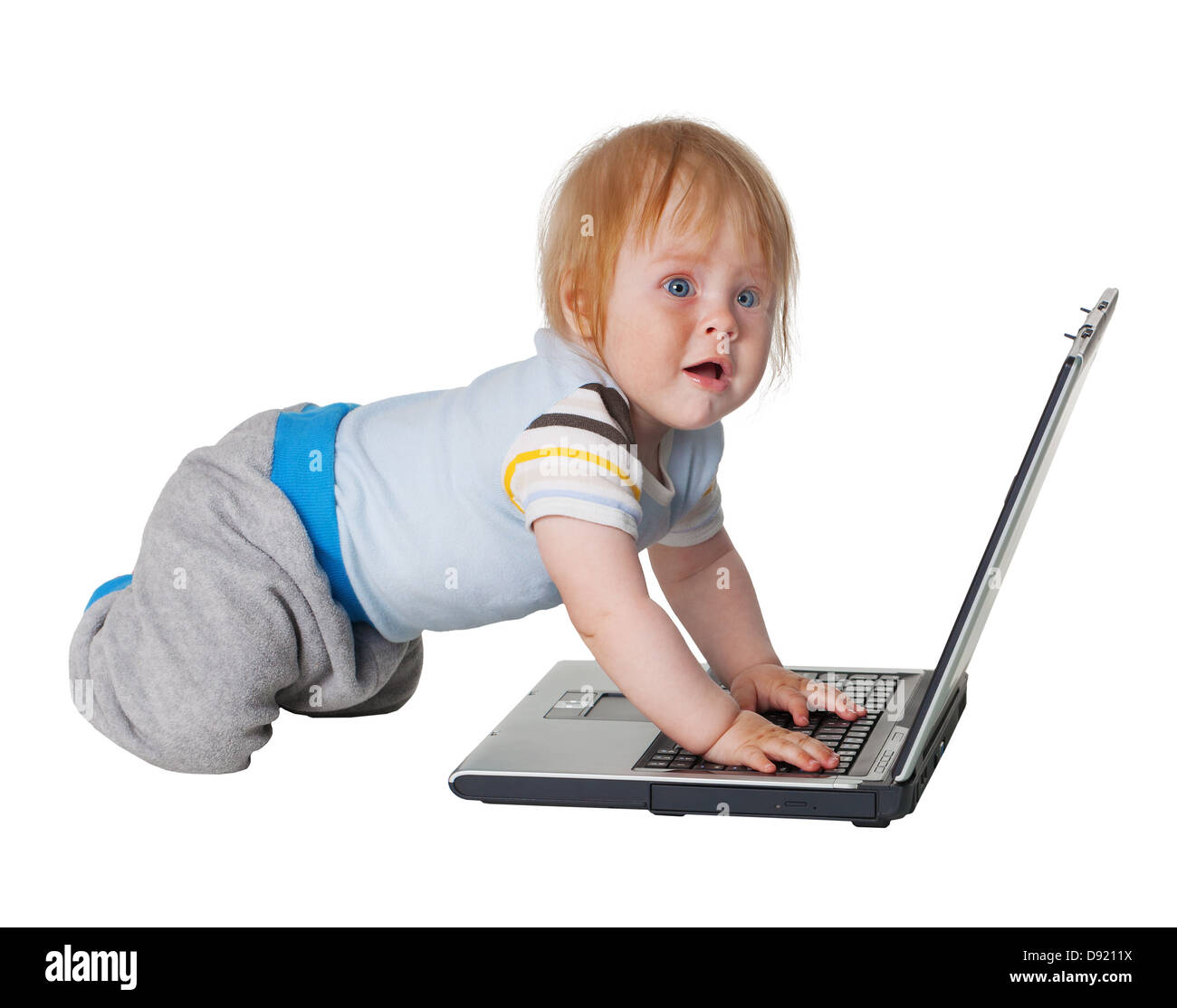 Despair - the difficulty of studying computer technology. Kid and laptop on white background - Stock Image
