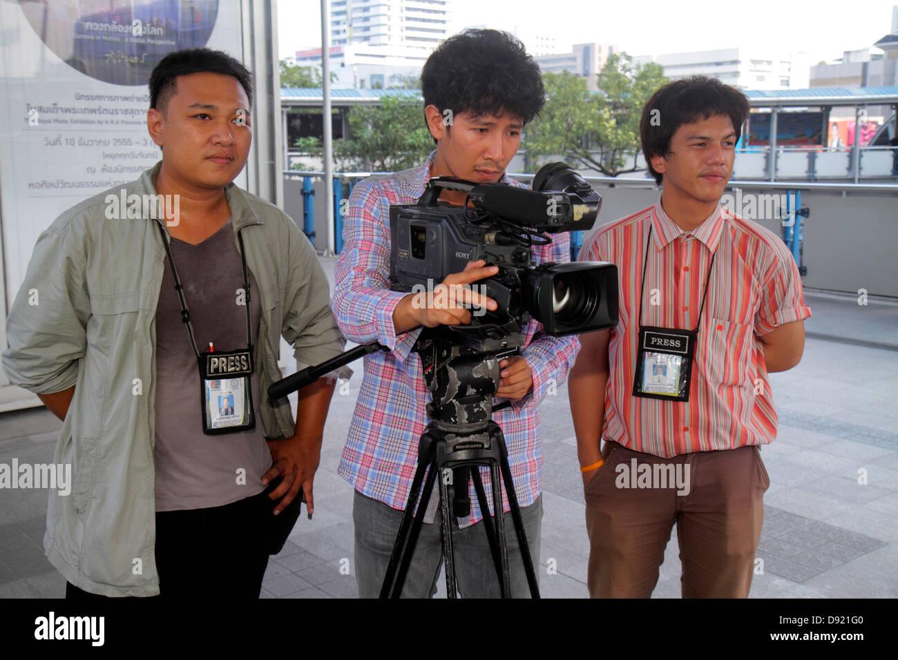 Asian camera man