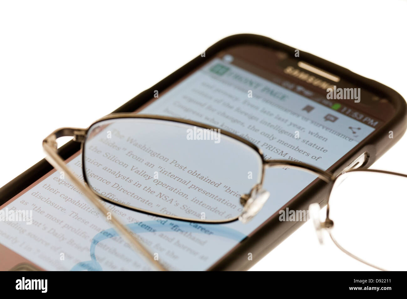 Reading glasses on smart phone - Stock Image