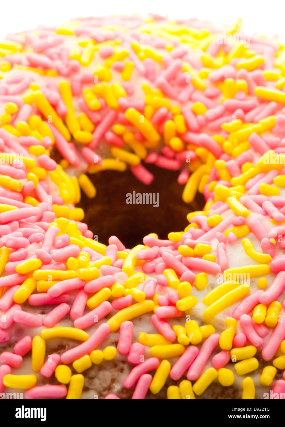 Close up of sprinkle donut - Stock Image