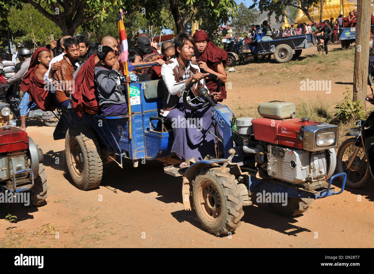 Buddhist Monks on a tractor at December full moon festival, Nyaungshwe, Inle Lake, Shan State, Myanmar Stock Photo