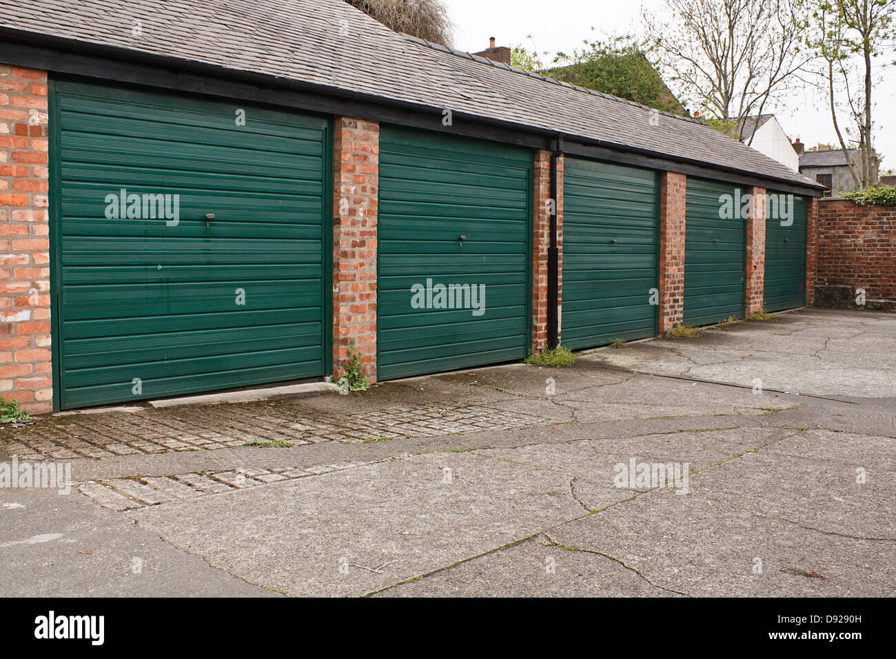 Residential garage block available to rent or lease often used for storage - Stock Image