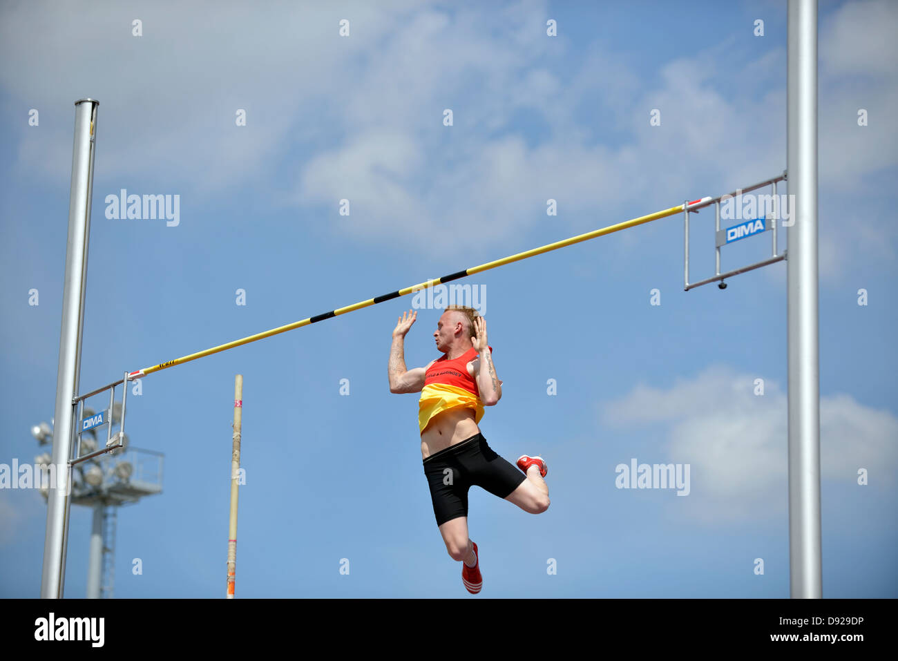 pole vaulter clears the bar at british athletics premiership meeting, sportcity, manchester - Stock Image