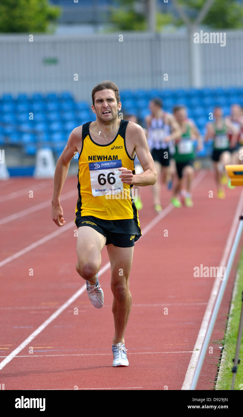 rory chesser winning the 1500m race at british athletics premiership meeting, sportcity, manchester - Stock Image
