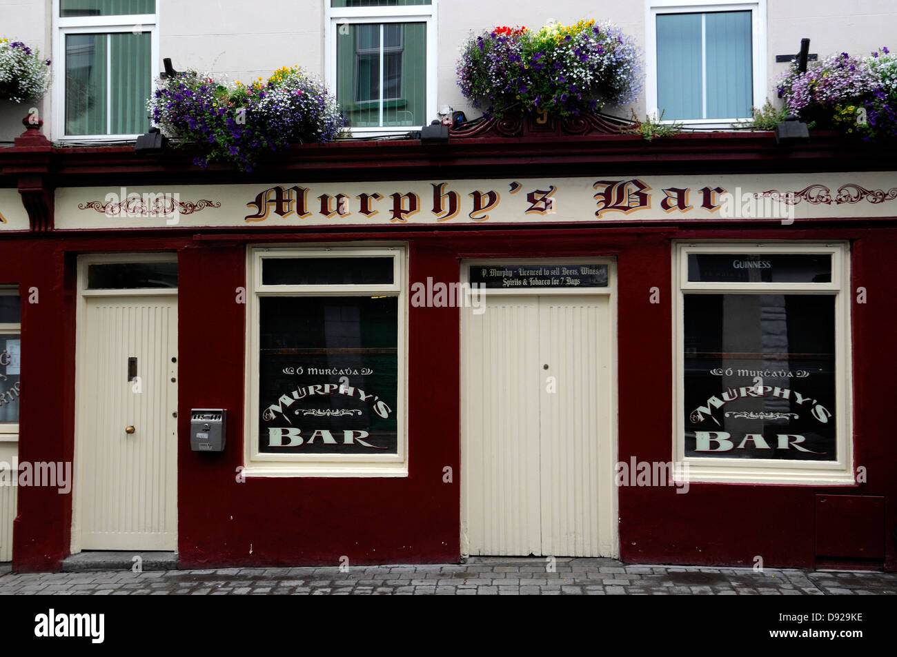 Murphy's bar pub licensed premises galway ireland frontal front street frontage view closed doors traditional - Stock Image