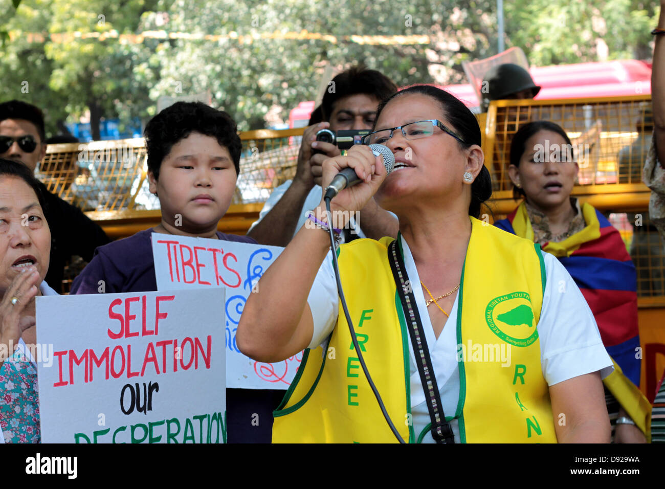 A Tibetan woman protests in New Delhi, India, against the Chinese occupation of Tibet. - Stock Image