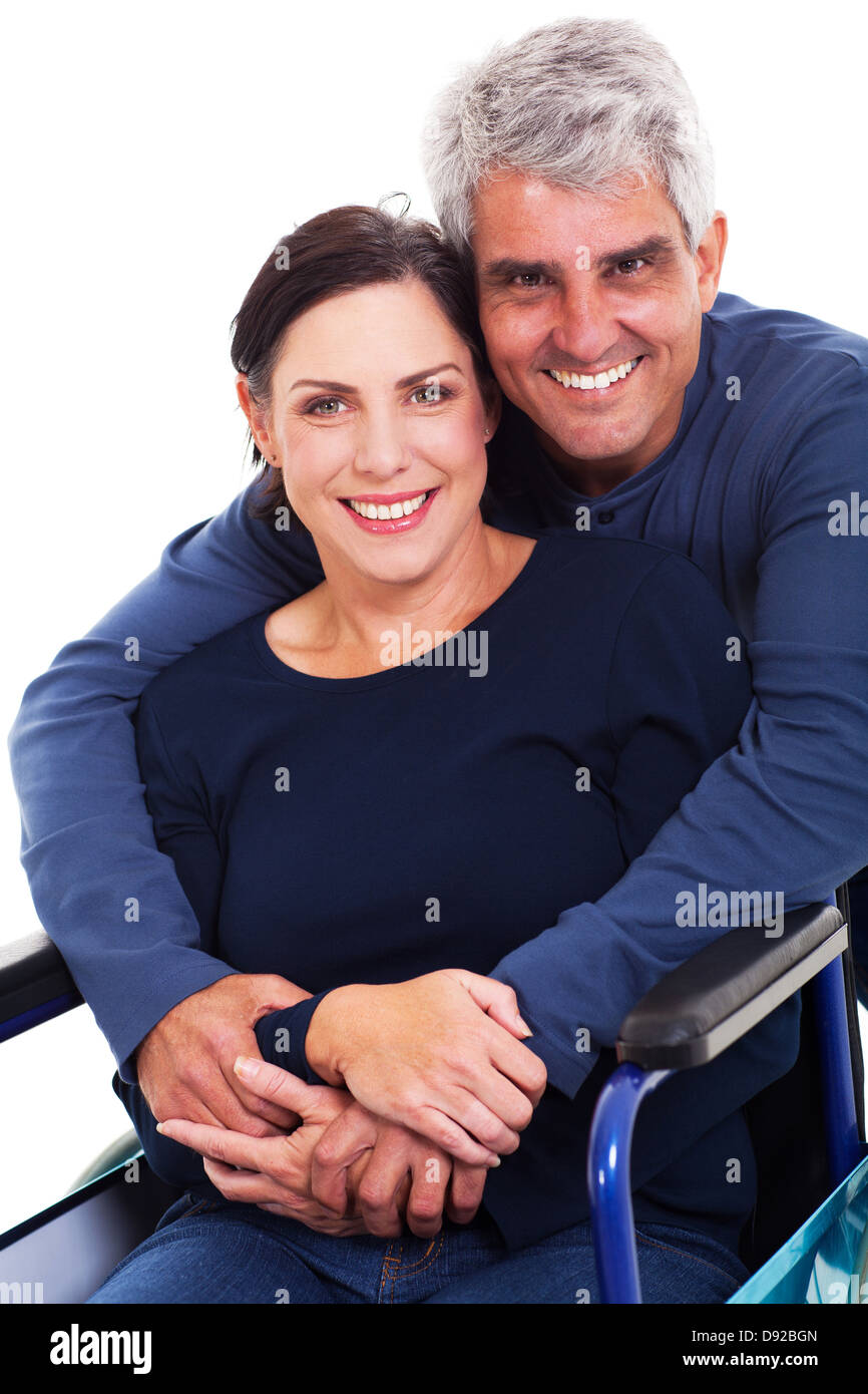 loving supportive husband hugging disabled wife isolated on white - Stock Image