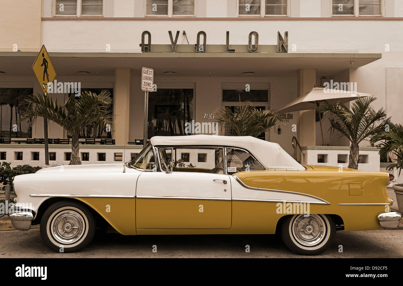 Old convertible Car outside Avalon Hotel in the Art Deco district of ...