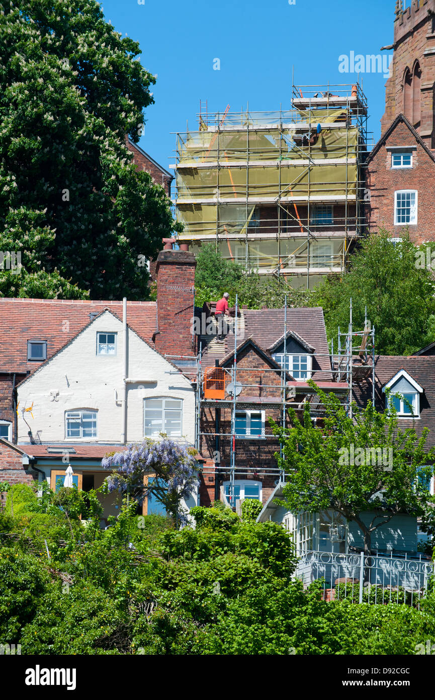 Builder working on house roof in Bridgnorth, Shropshire - Stock Image