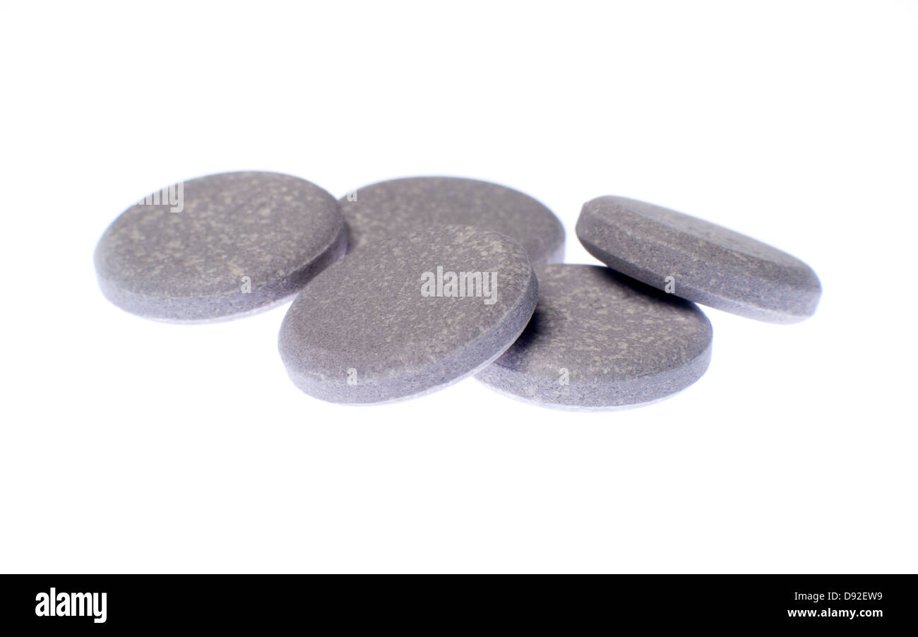 A group of antacid pills isolated on white background - Stock Image