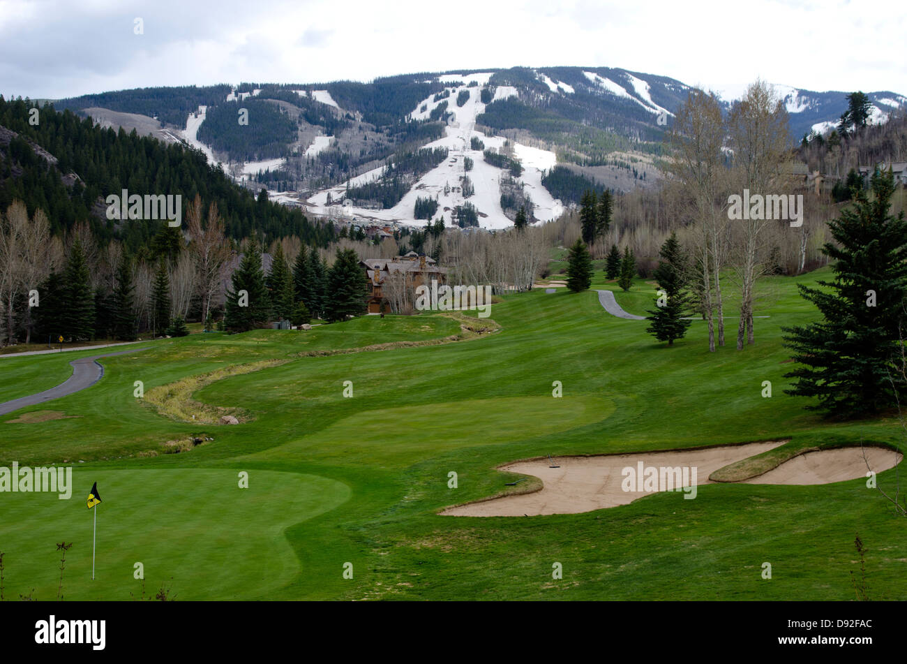 Combining two sports from separate seasons, a tourist can play golf on the Beaver Creek Golf Course on the same - Stock Image
